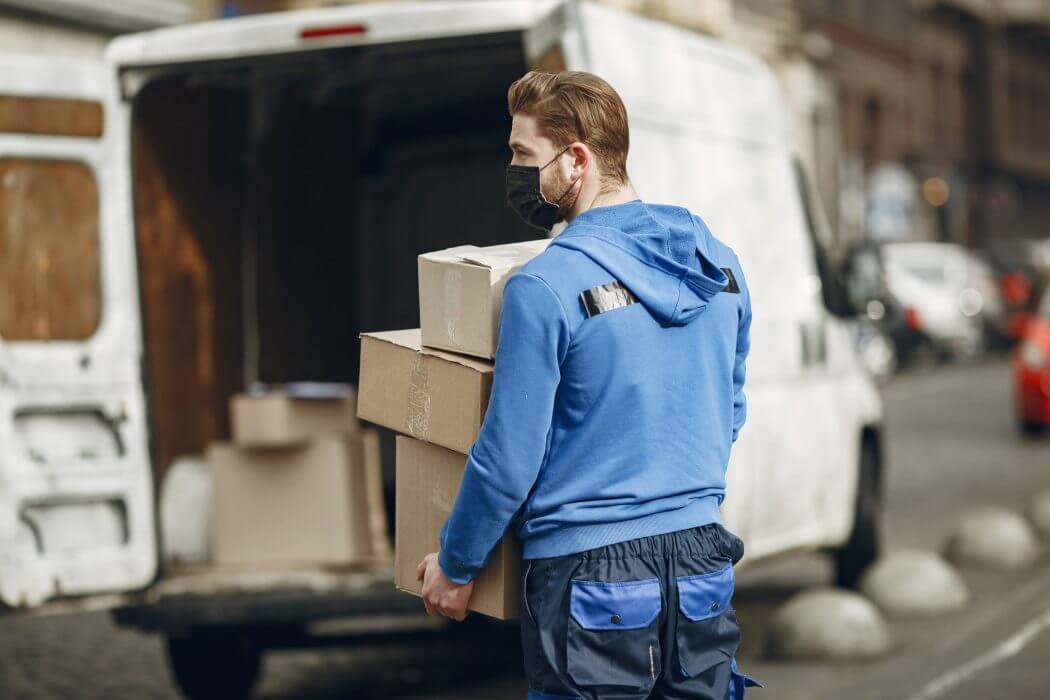 a delivery man receiving package from customers for reverse logistics