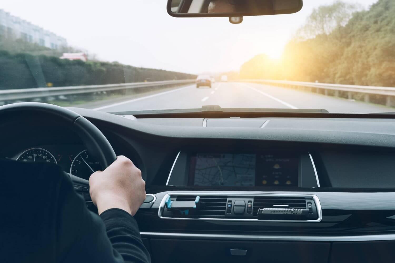 a man drives a car safely