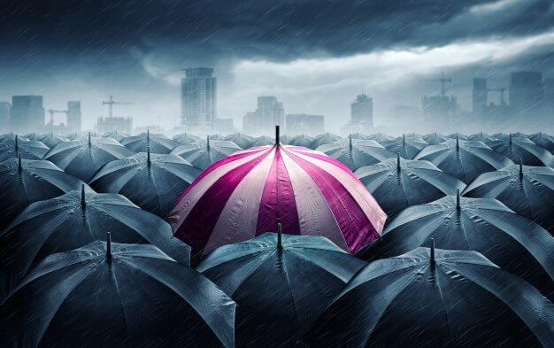 Pink-and-white-umbrella-with-dark-stormy-clouds