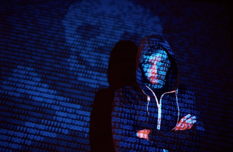 supply chain hacker wareing undetectable hoodie