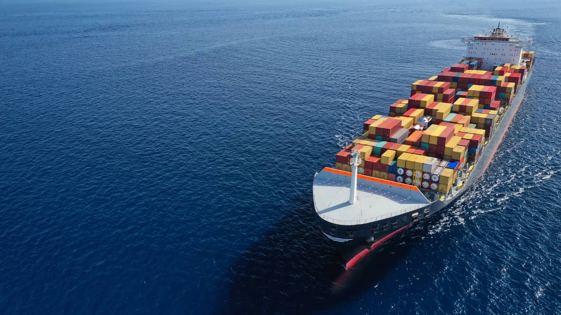 a ship is sailing in the sea to import and export product by sea frieght
